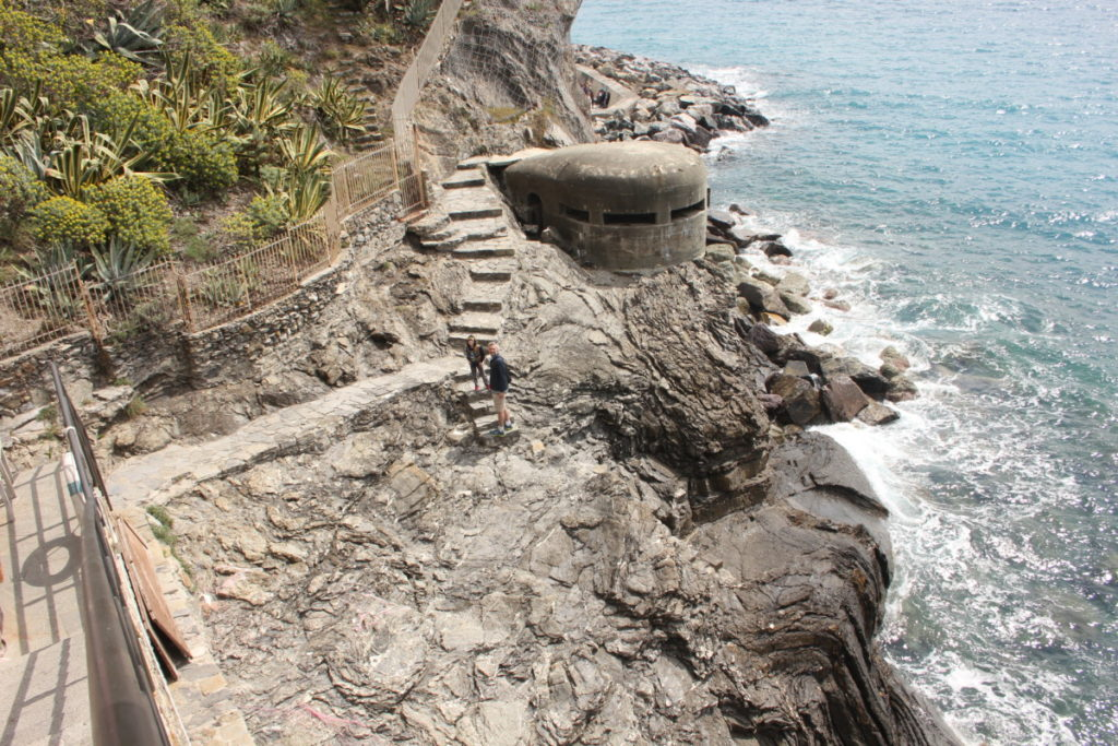 a dad and son on the coastal hike between Vernazza and Corniglia with a war bunker, Cinque Terre Italy