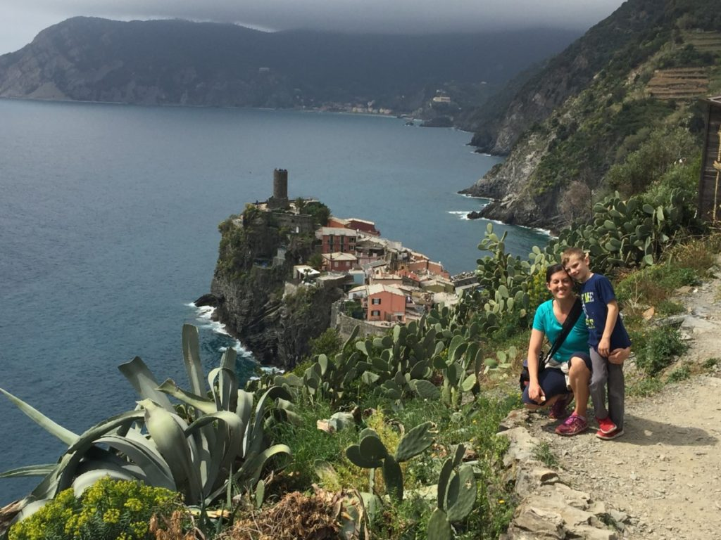 A mom and son hiking with the view of Vernazza and Monterosso in the background, Cinque Terre, Italy