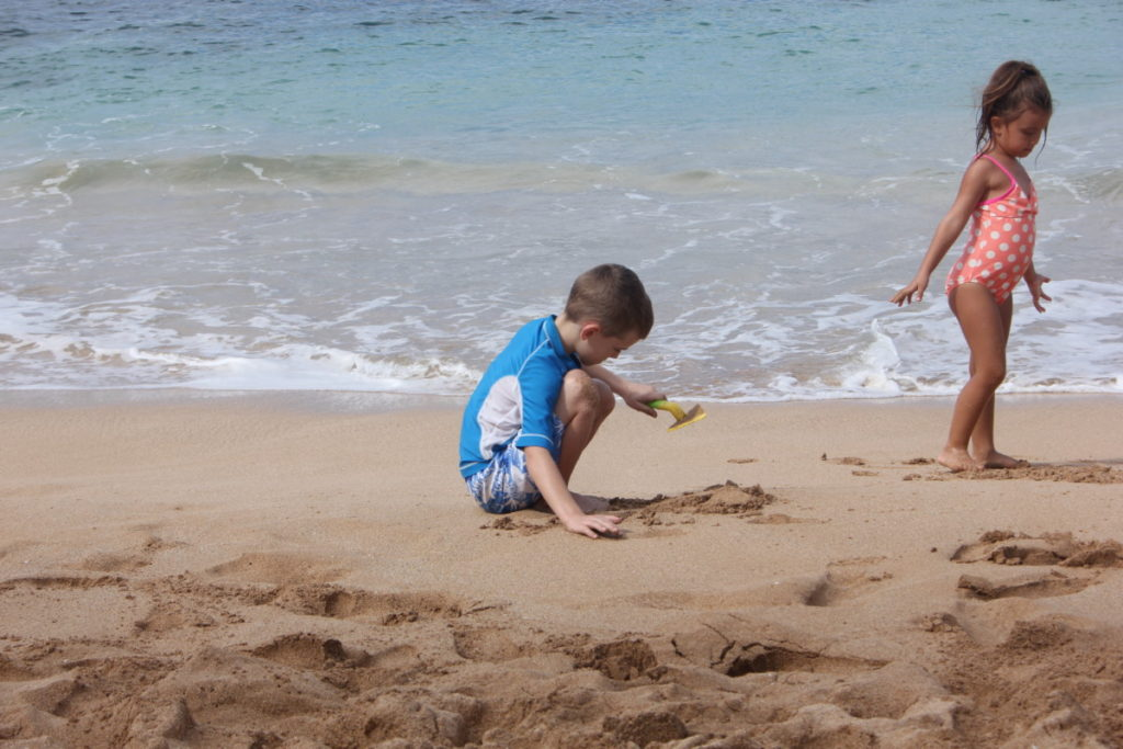 Kids Play on Napili Beach on Maui, Hawaii
