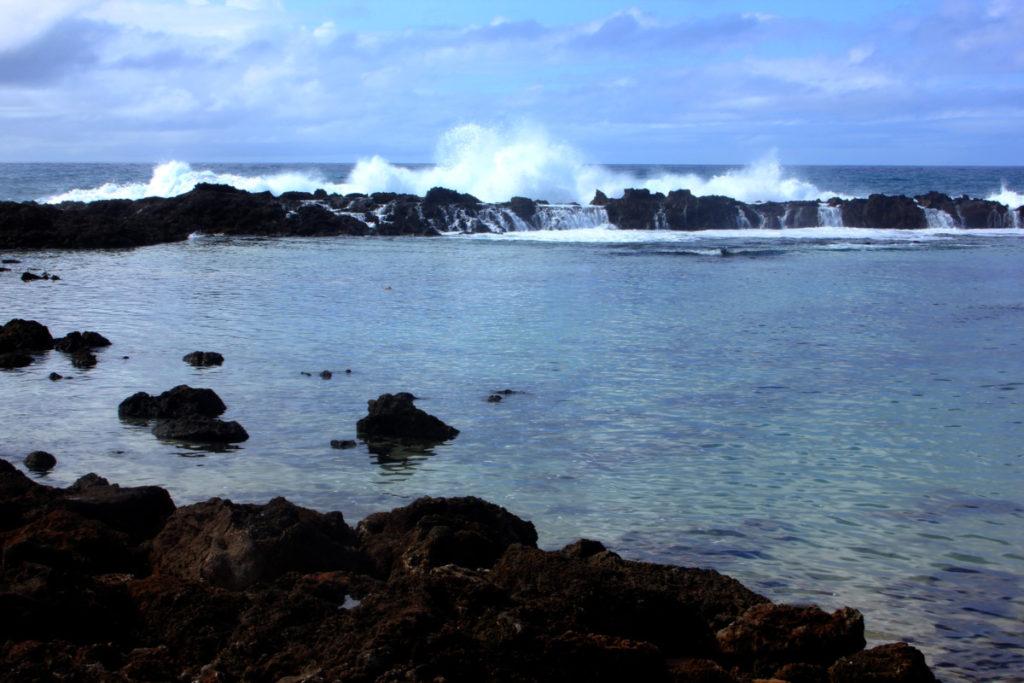 Waves crash at sharks cove beach on Oahu, Hawaii