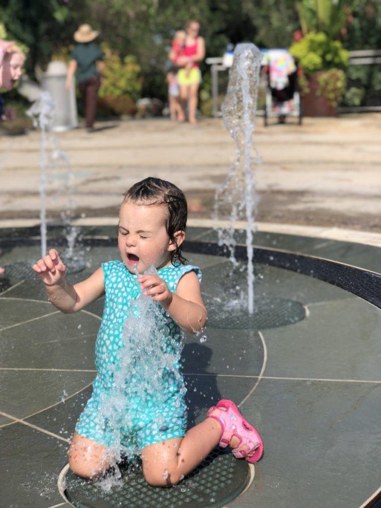 Baby gets wet at Splash pad