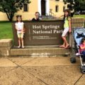 4 kids in front of Hot Springs National Park sign