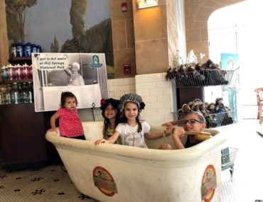 Clothed kids in a tub at Hot Springs National Park