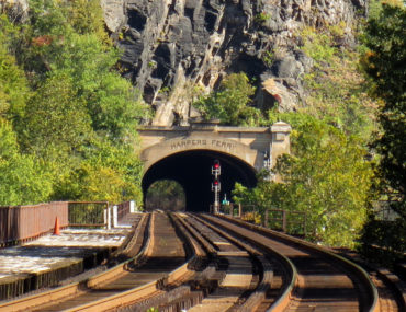 Train tracks leading to the bridge under the mountain at Harper's ferry, Virginia