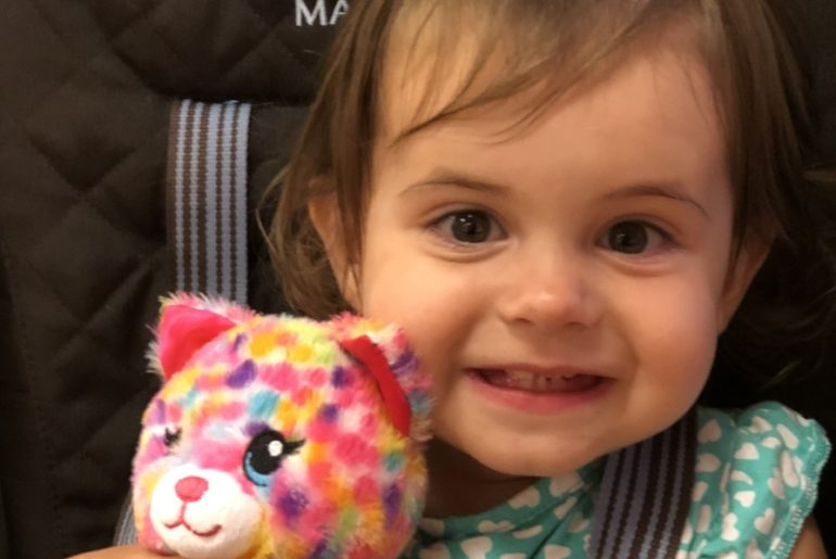Smiling baby with a stuffed animal