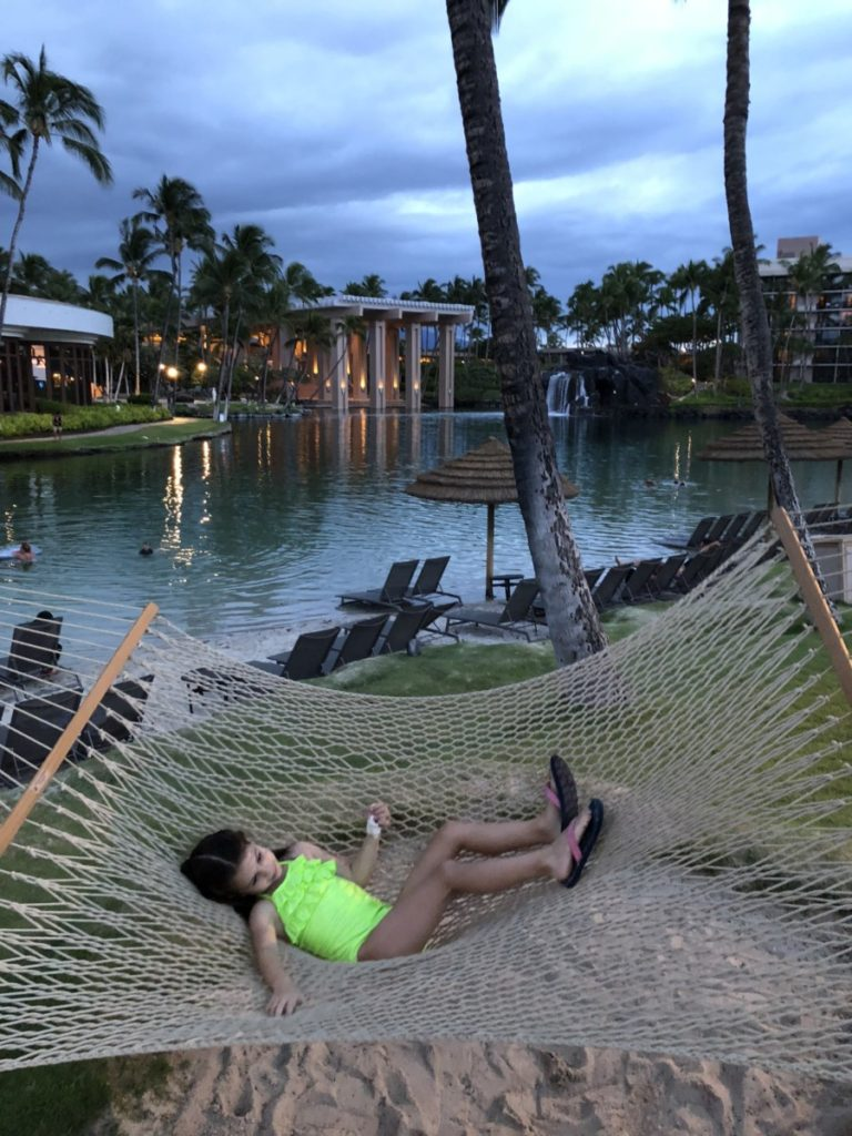 a girl in a swimsuit relaxing in the Hammock at Hilton Waikoloa