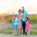 Family of 6 in Tandy Hills Natural Area with Fort Worth cityscape in the background