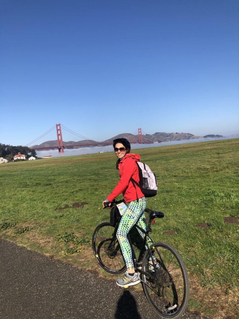 a woman Biking on the way to Golden Gate Bridge San Francisco