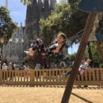 Young Girl swings in front of the Sagrada Familia in Barcelona, Spain