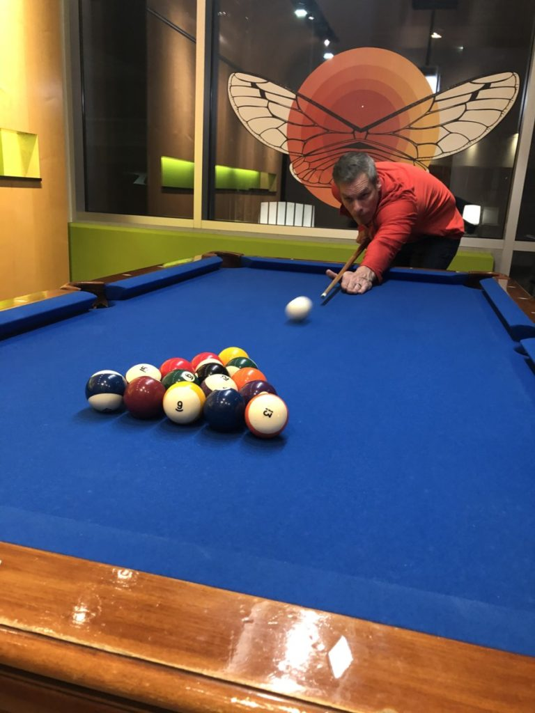 A man break the pool triangle at Aloft Hotel Billiards in downtown OKC