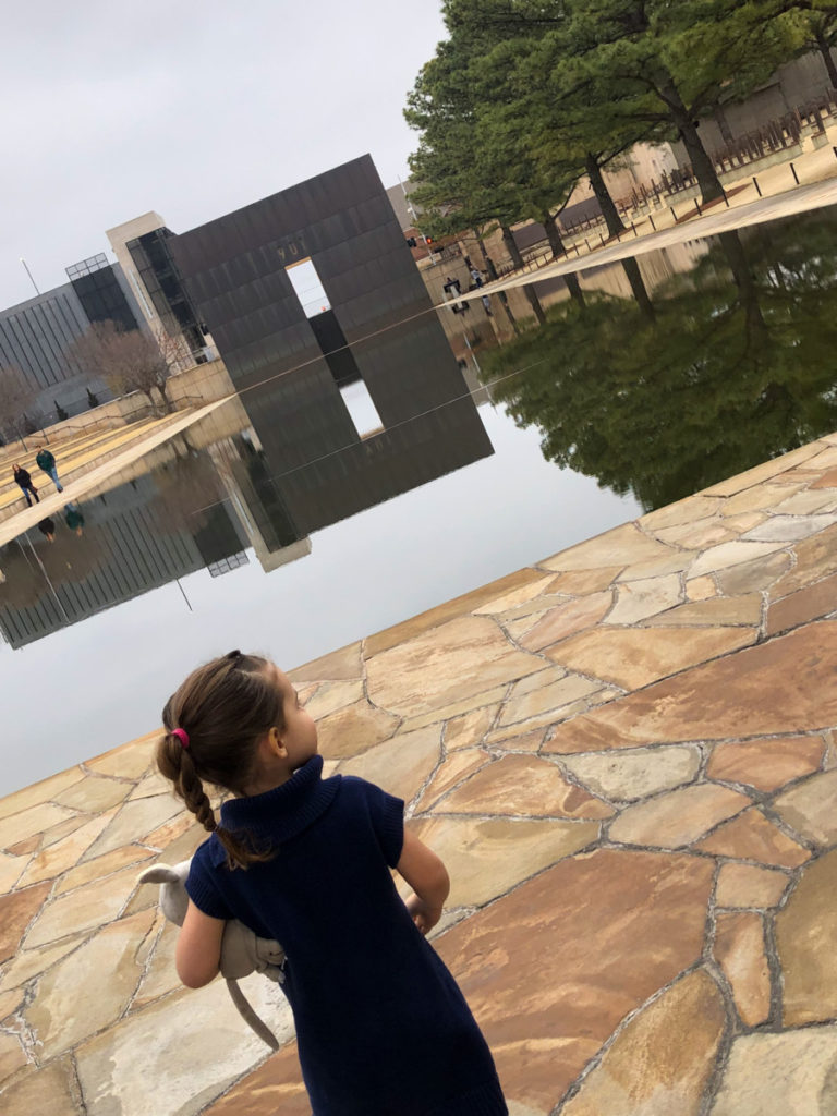 Toddler looks over the reflection pool at the Oklahoma National Memorial Plaza