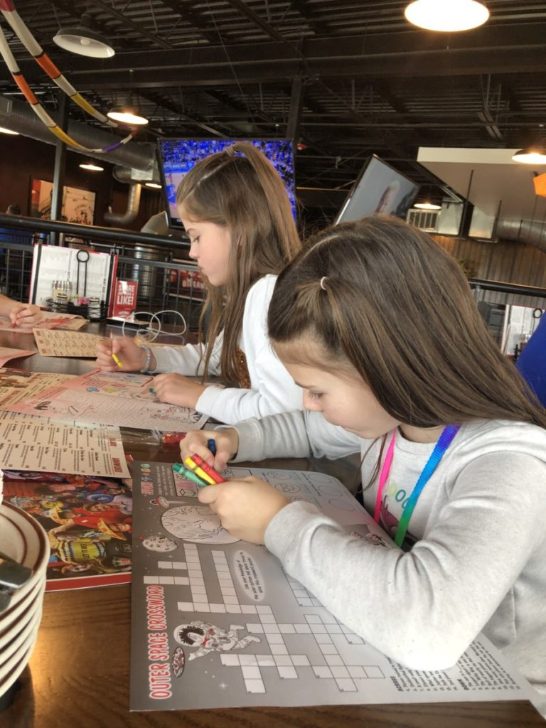 2 girls color kids menus at Hideaway Pizza in OKC