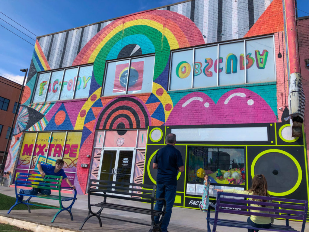 Colorful front of Factory Obscura Mix tape art installation in Oklahoma City, OKC with kids