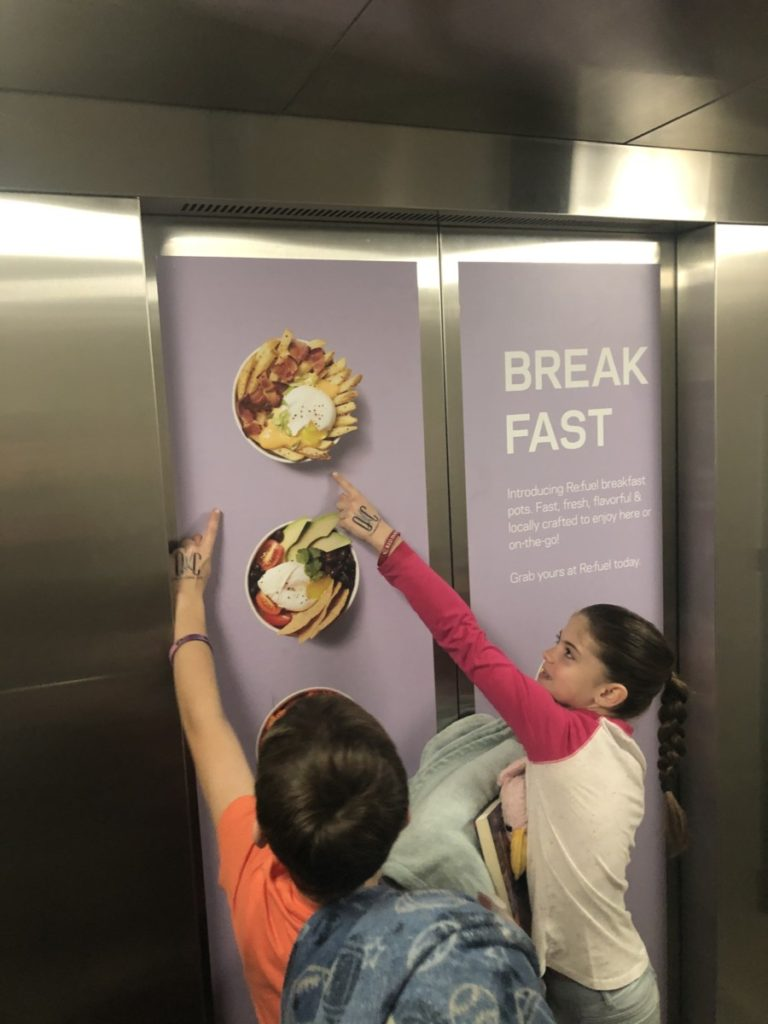 2 kids point to the breakfast choice at Aloft Hotel in Downtown OKC