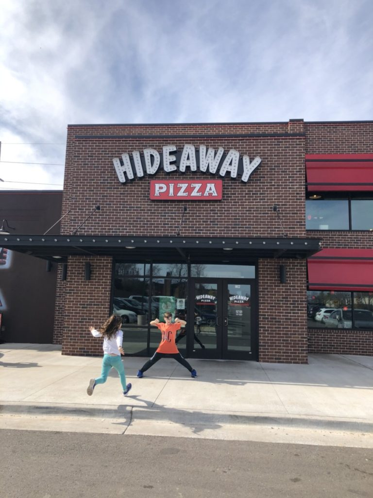 2 kids running for Hideway pizza place for lunch in OKC