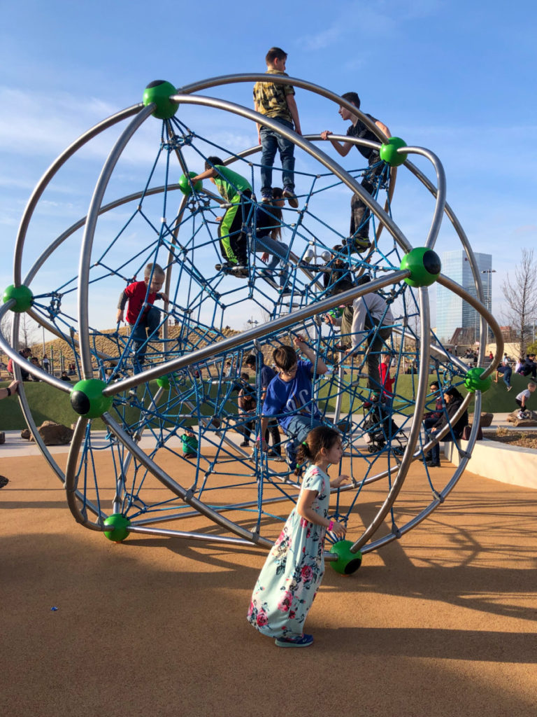 Net climbing at Scissortail Park in OKC with kids