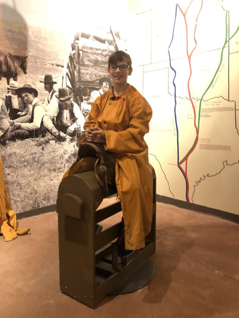 A boy sits on a saddle at the Oklahoma History Center in OKC