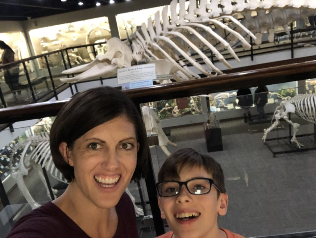 Mom and son in front of Whale Skeleton at the Osteology Museum in OKC