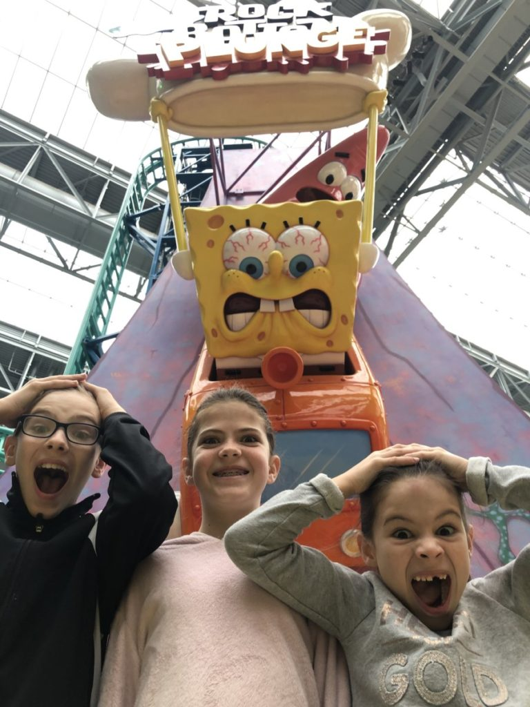 3 kids look squared at Spongebob Squarepants Rock Bottom Rollarcoaster at Nickelodeon Universe