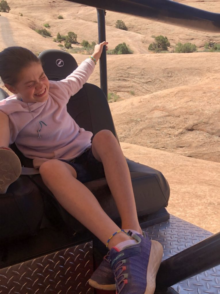 Young Girl sqealing on the Hummer Safari Tour at Moab adventure Center