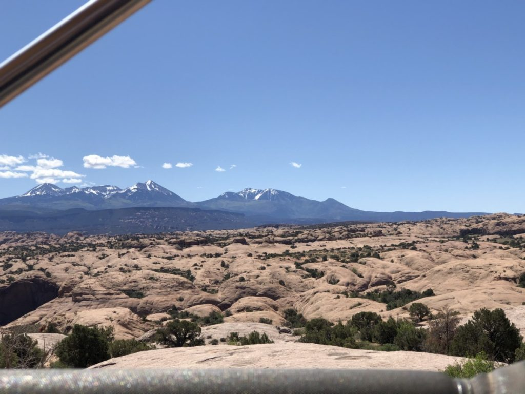 Views of snowcapped Mountains from the red rocks of Moab Adventure Centers Hummer safari Tour