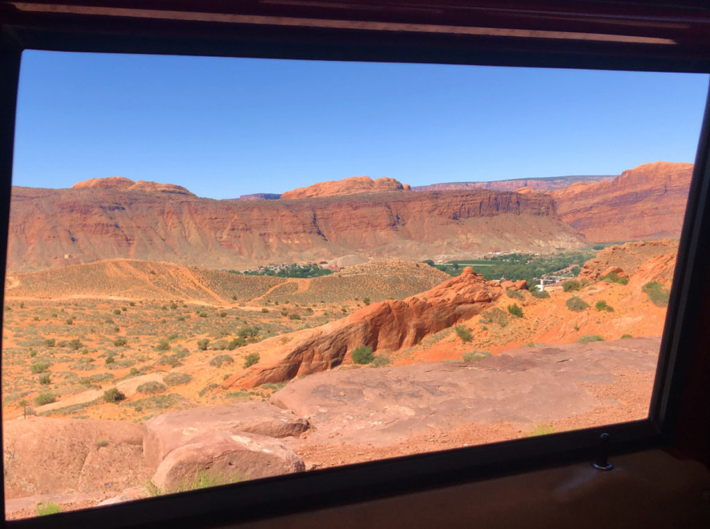 Red rock boulders and canyons from the window of a Hummer Safari Tour from Moab Adventure Center