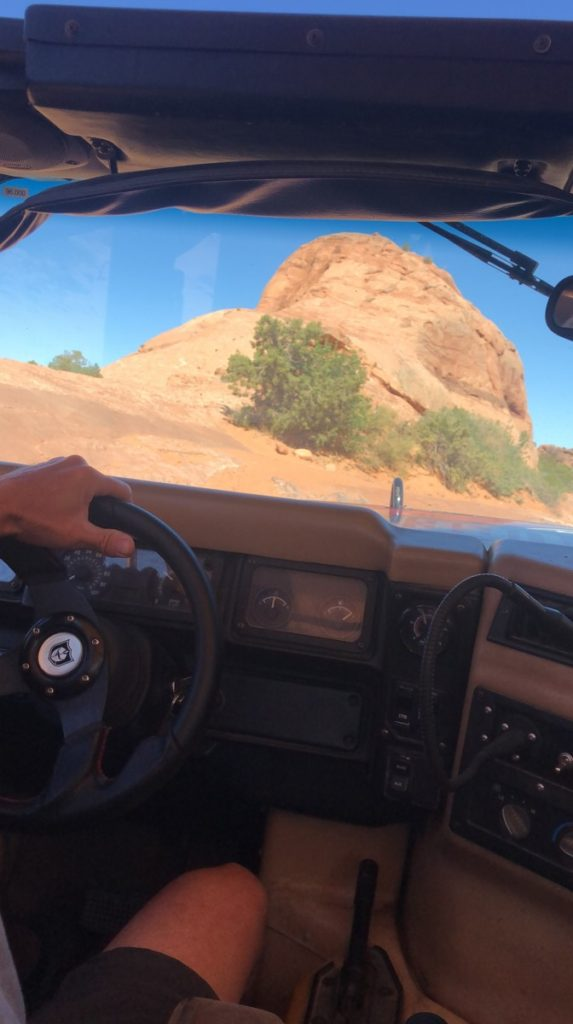 view of the red rock from the window of a Hummer Safari tour through Moab Adventure Center