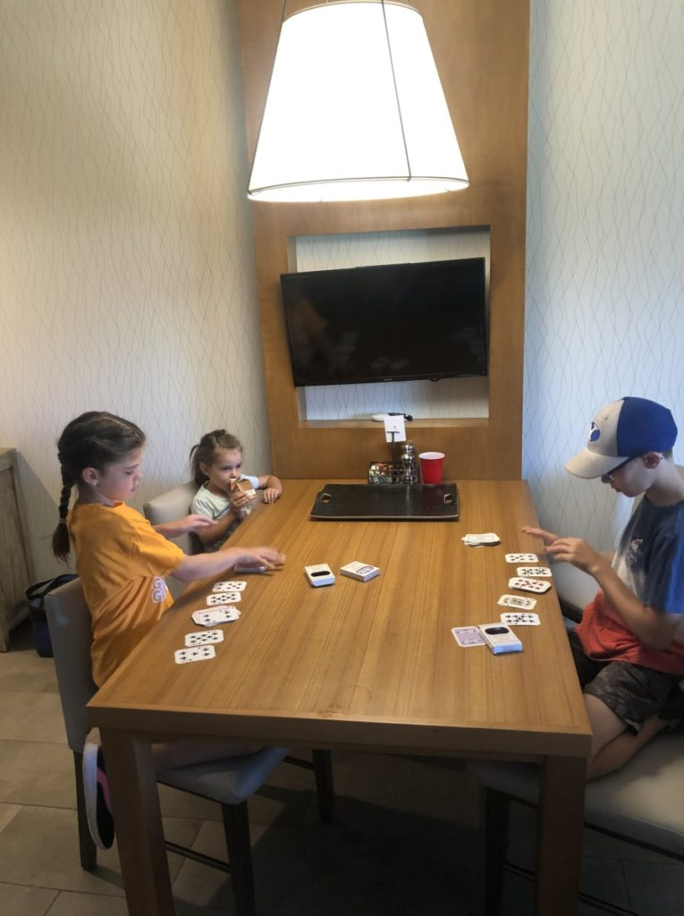 3 Kids playing cards at the Casita in Hyatt Place Moab