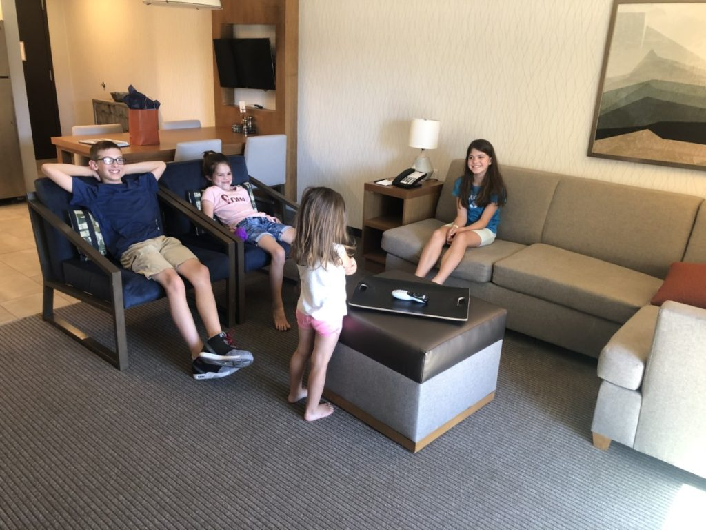 4 kids in the living room area of the casita in Hyatt Place Moab