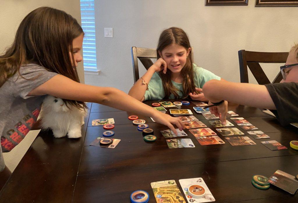 3 kids playing family games splendor
