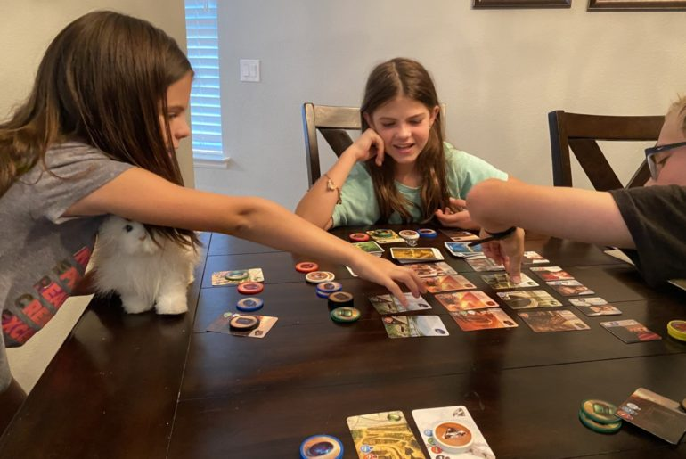 3 kids playing family games splendor