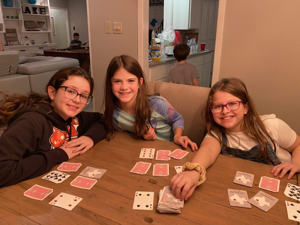 3 girls playing card games
