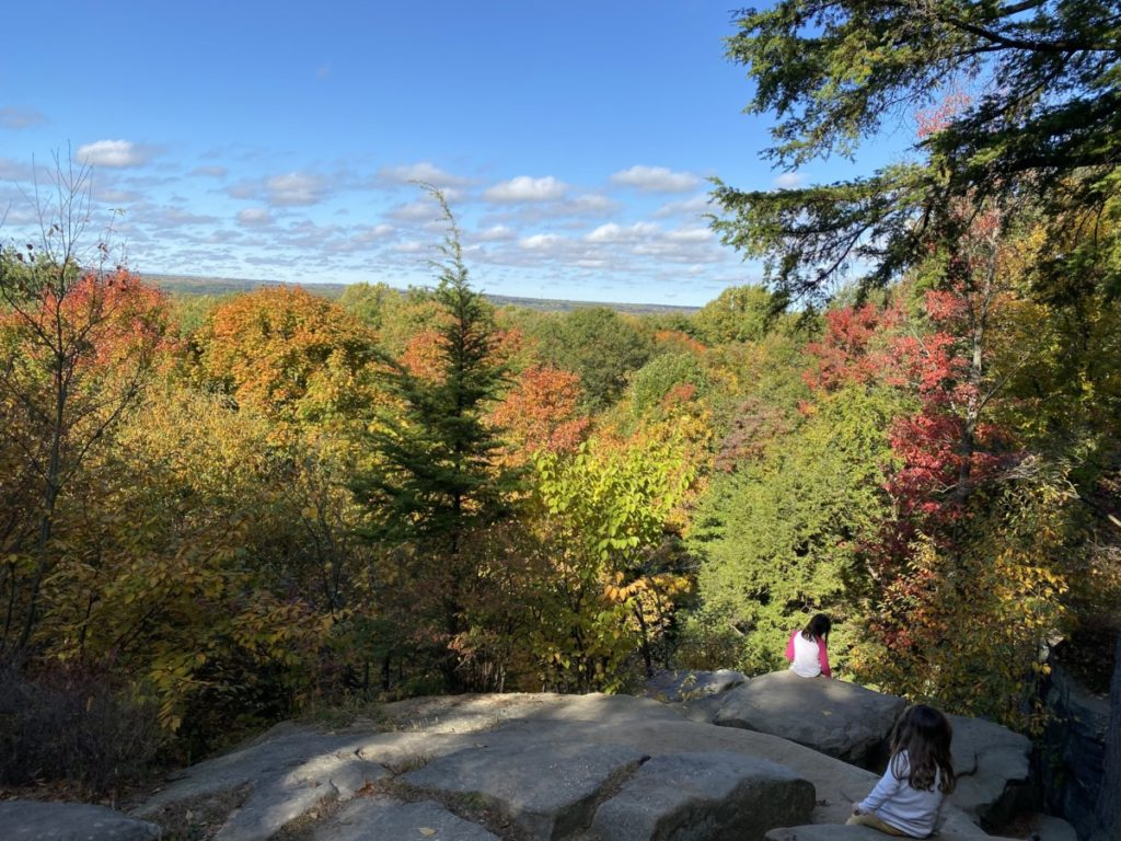 Overlook of fall colored trees and blue sky in Cuyahoga Valley National Park with kids