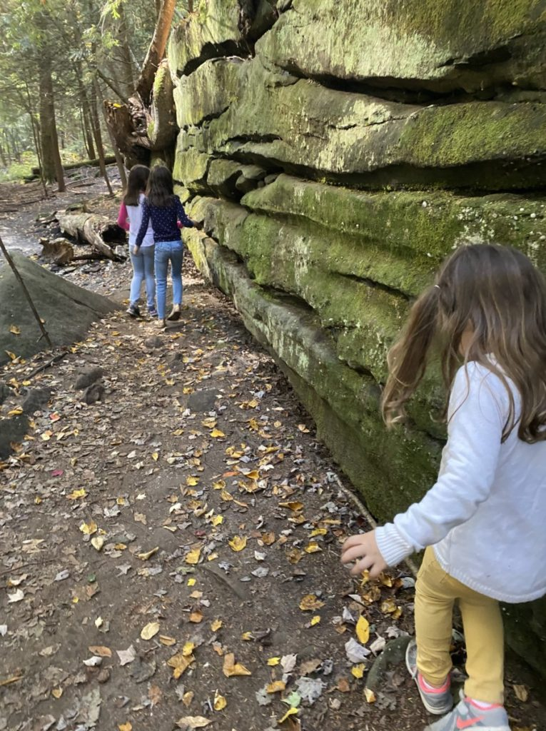 3 girls hike by the mossy ledges at Cuyahoga National PArk in Ohio