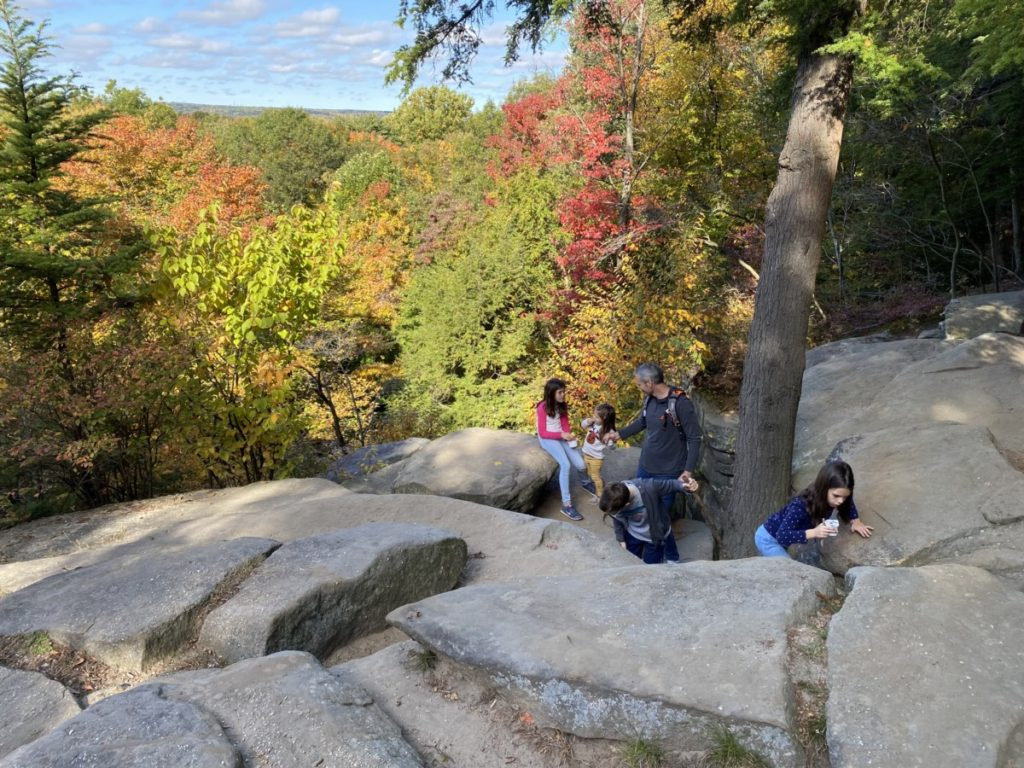 Dad and 4 kids explore the boulders at the Ledges overlook in Cuyahoga Valley National Park with kids