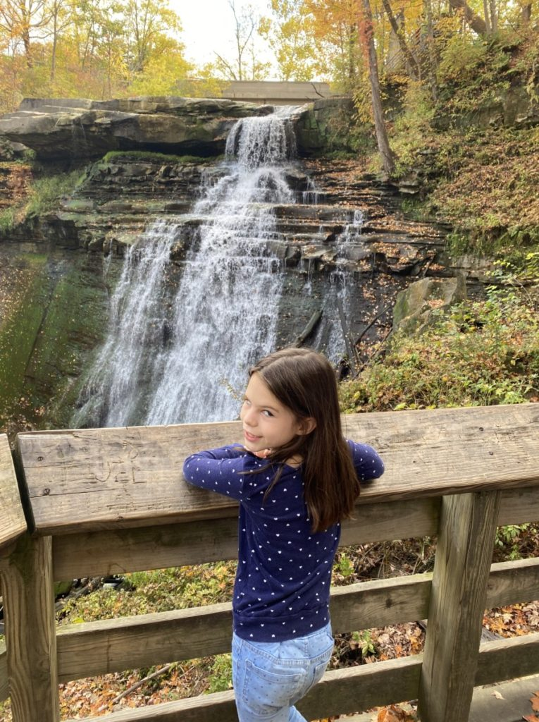 A girl on the boardwalk overlook of Brandywine Falls in Cuyahoga National Park in Ohio