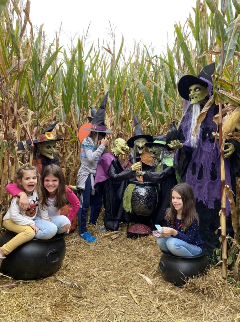 4 kids with witches scene inside the Szalays farm Corn Maze in Cuyahoga Valley National Park