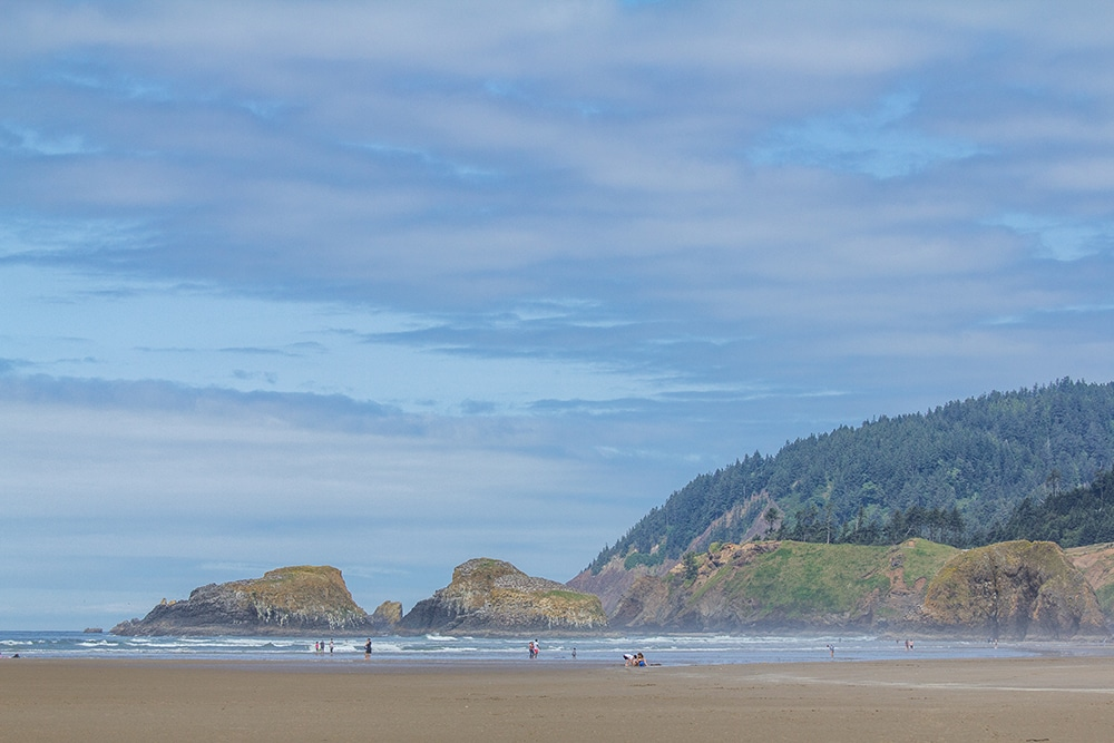 Mountain rises out of the ocean at Cannon Beach in Oregon