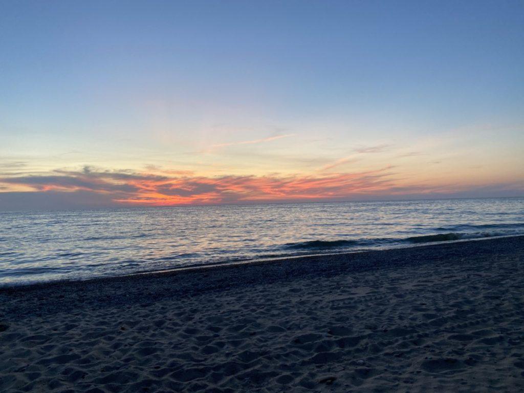 sunset on the Oval Beach in Saugatuck Michigan