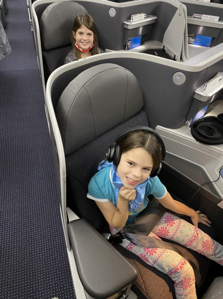 2 girls sit in First Class seats travel to hawaii during COVID