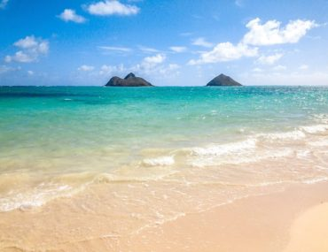 Blue water and small islands off the coast of Lanikai Beach on Oahu Hawaii